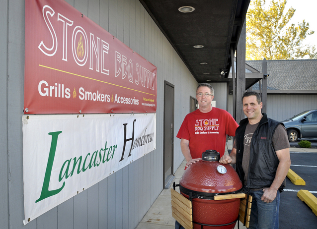 Stone BBQ Supply owner Michael Stone, left, stands with Lancaster Homebrew owner Mark Garber